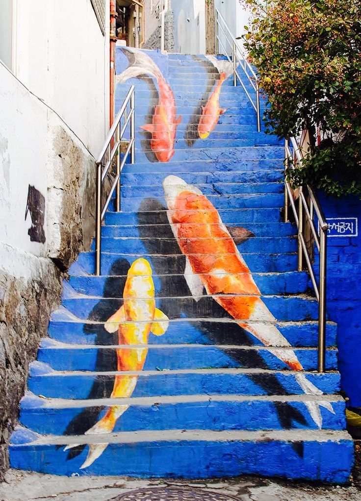 Koi steps in the Ihwa Mural Village located in Ihwa-dong neighborhood within Jongno-gu, Seoul, South Korea.  Ihwa Mural Village began in 2006 when the local Public Art Committee, together with 60 artists, joined to paint the walls of the houses in the village with beautiful wall murals and installed other art pieces to improve the local environment.