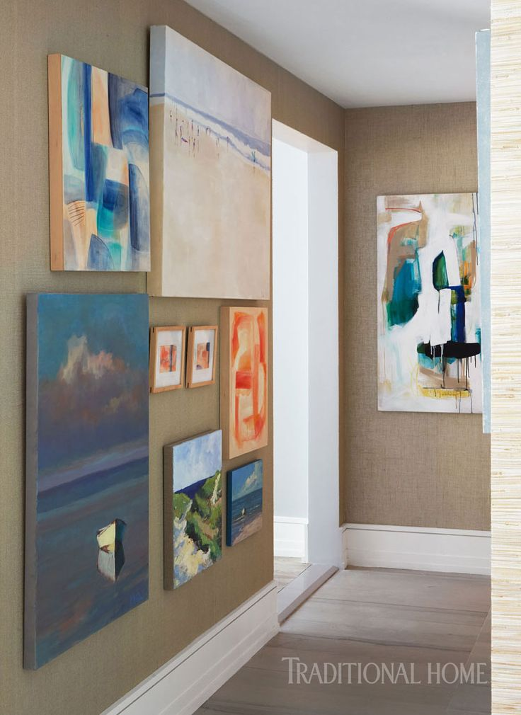The gallery hall features abstract and oceanic artwork from serena lily photo