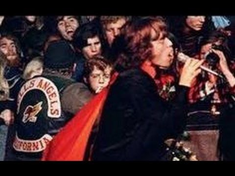 """Rolling Stones - Sympathy For The Devil  (Live Altamont, 1969)""""ENDOF""""PEACE/HIPPIE WOODSTOCK NON VIOLENCE W/MURDERBY""""HELLS ANGEL""""}""""ALTAMONT SPEEDWAY LIVE(SUPPOSEDLY """"MICK&KEITH"""" THOUGHT THIS WOULD ECLIPSE """"WOODSTOCK 69""""{THEY SKIPPED IT""""} {DAY OF HISTORY/DAY OF INFAMY IN ROCK HISTORY/LEGEND""""WHO ELSE BUT """" THE STONES(R.I.P. BRIAN JONES""""):RE:COMMENTS FROM """"GIMME SHELTER""""""""THE STONES"""" {{LOVED""""MARY CLAYTON'S VOCALS ON ORIGINAL VERSION/VIDEO(CIRCA 1969"""