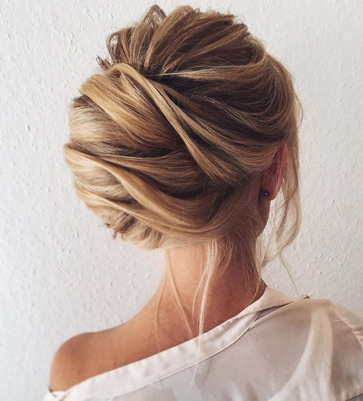 Pretty chignon hairstyle for long hair - Side-parted,Chignon Wedding Hair. Get inspired with this hand-picked bundle of bridal that are sure to bring out