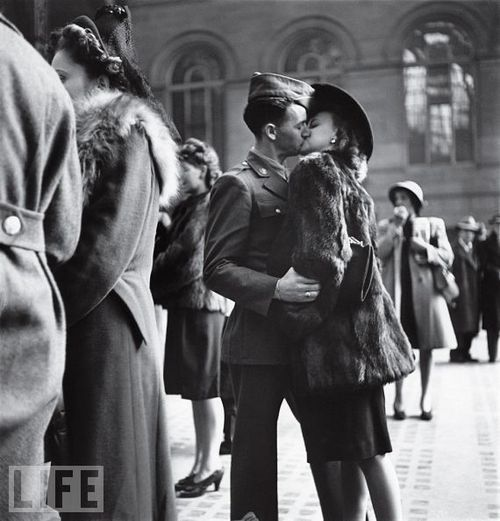 In this and dozens of other, similar pictures made at New York's Penn Station, LIFE's Alfred Eisenstaedt captured a private moment repeated in public millions of times over the course of the war: a guy, a girl, a goodbye — and no assurance that he'll make it back. By war's end, more than 400,000 American troops had been killed. : Picture, Photos, Kiss, Life, Vintage, Alfred Eisenstaedt, Photography, War