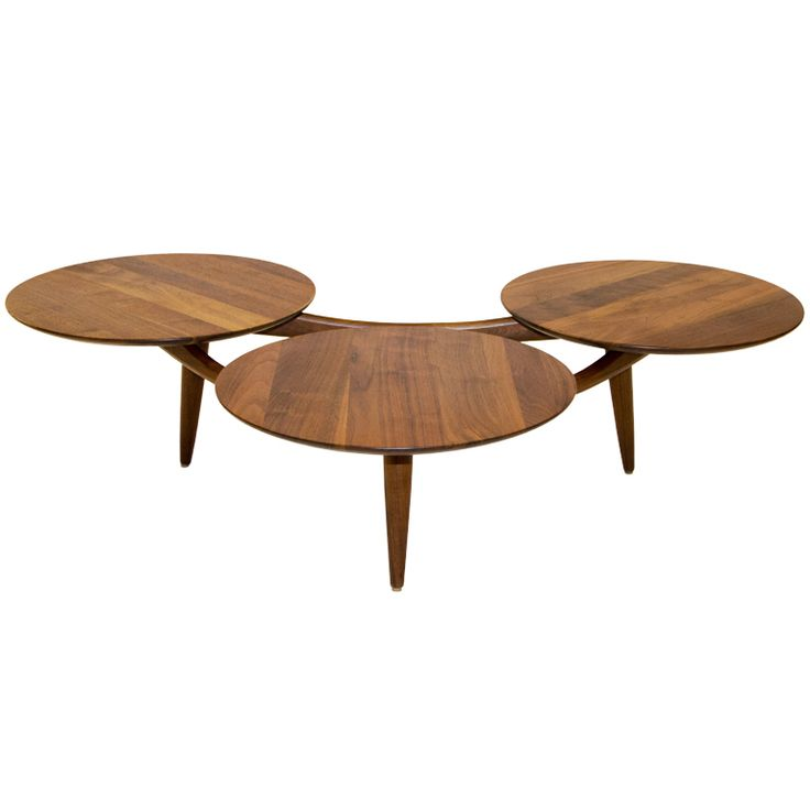 TITLE: Walnut Coffee Table Three Disks -after Greta Grossman  PRICE:$2,400 Purchase >  IN THE STYLE OF: Greta Grossman (Designer)  COUNTRY: United States  CREATION DATE: 1950's  MATERIALS: Walnut  CONDITION: Good. No scratches or stains  LENGTH: 4 ft. 4.5 in. (133 cm)  DEPTH: 38 in. (97 cm)  HEIGHT: 13 in. (33 cm)  DEALER LOCATION: San Francisco, CA  NUMBER OF ITEMS: 1  REFERENCE NUMBER: LU9155768383