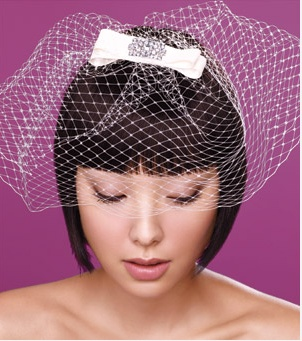 Looking for a retro look? This birdcage is perfect. With an adorable bow (with some bling) on the top, you can add some whimsy to your wedding.