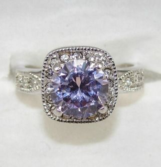 Tanzanite Engagement Ring. Gorgeous! www.AlternativeEngagementRingHQ.com/tanzanite