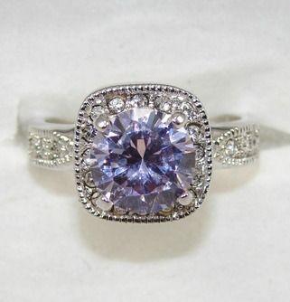 Tanzanite Engagement Ring.  Gorgeous!  www.AlternativeEngagementRingHQ.com/tanzanite