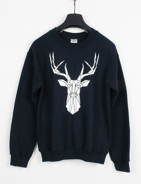 Super comfy medium weight crew neck graphic stag sweatshirt for men or women. Available in a range of colors. Please check photos for options. This sweater would make a great gift for either men or women. If you are looking for a cool alternative for the Christmas jumper party, this is a perfect choice, it can be worn all year round.   Cool casual streetwear with small Stencilize Stag logo printed on the back collar. The geometric stag is a print of my original handmade stencil art. I print…