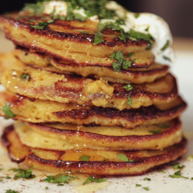 """Laz unites flavors from the south with flavors of Mexico in these pimento poblano corn cakes. They're cheesy, light, and as Laz says, straightup """"bomb""""."""