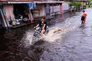 Jakarta, Indonesia. Flooded roads in Selat Panjang caused by heavy rainfall and the overflowing Ciliwung river