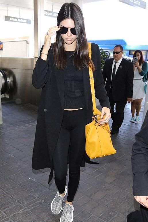 20c42560a23 Kendall Jenner wearing Adidas Yeezy Boost 350 Sneakers and Louis Vuitton  Keepall Bandouliere 45 Duffle in Damier Infini Leather in Solar