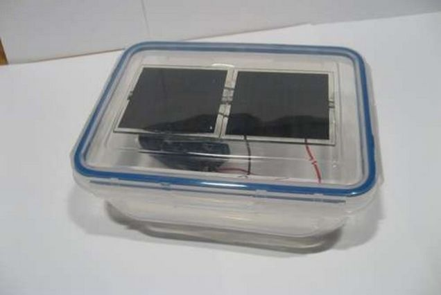 There's no need to pay the electric company to charge your small electronics when you've got a portable solar charger on hand. Learn how to turn some cheap solar panels and a Tupperware container into a solar charging station.