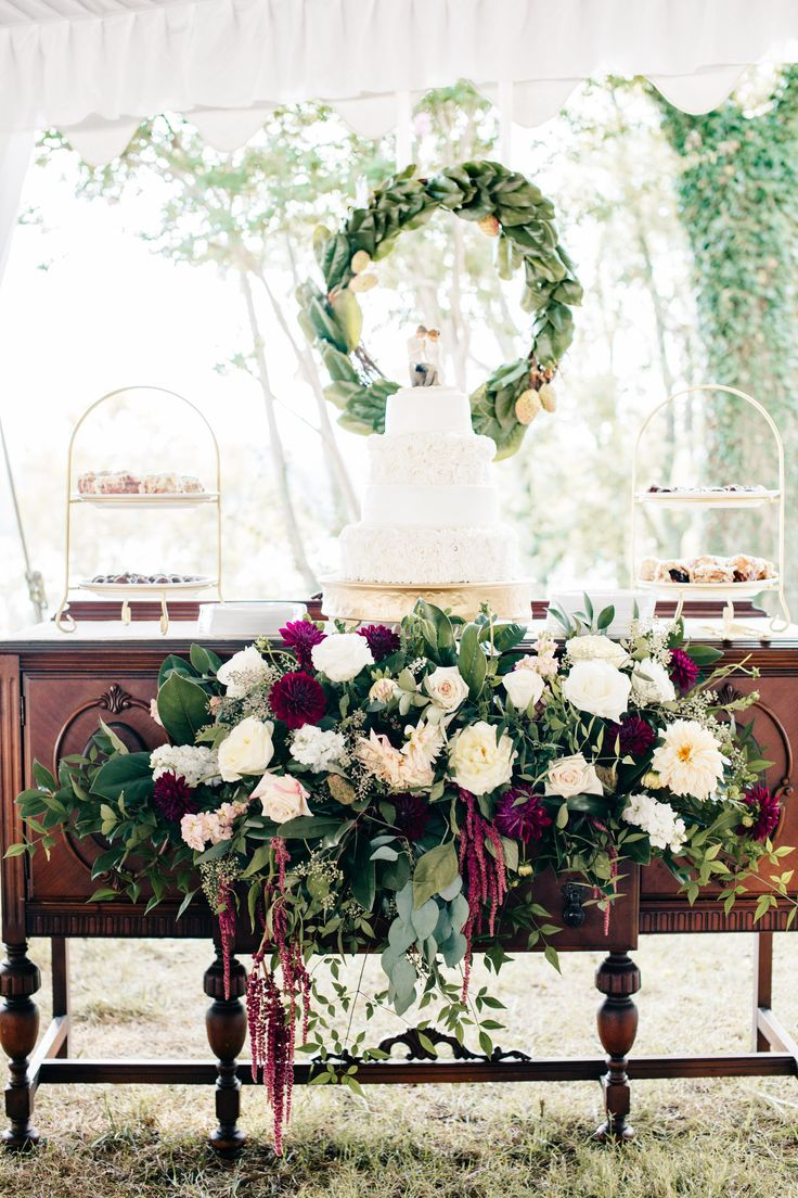 Wedding reception dessert table, romantic white and red florals, white wedding cake, wreath, antique buffet table // Natalie Jayne Photography
