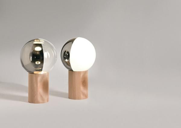 Je Suis table light from Penta. There is also a version with a marble base.