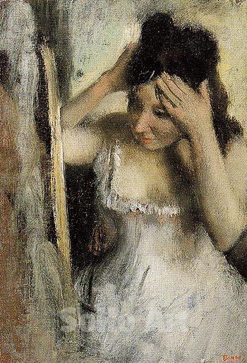 Edgar Degas - Woman Combing Her Hair before a Mirror_1877.