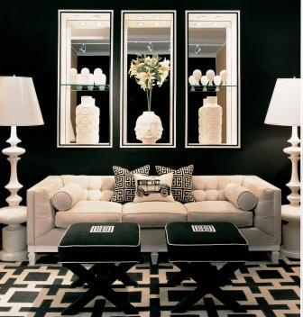 Dark, black and cream living room with a tufted sofa and geometric rug