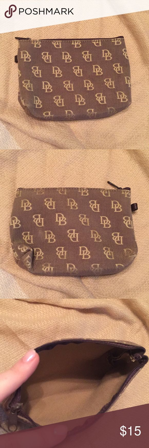 🚨Moving Sale🚨 Dooney & Bourke Mini Makeup Bag Great mini Makeup Bag in. Neutral color by Dooney &  Bourke. It's great for the necessities and can easily be thrown into a drawer at work, your purse, the glove box...I'm just now realizing how many sets of necessities I have...suffice to say, it's adaptable to whatever you need it to be🙂 H:4in L:6.25in W:.5-1.75in Dooney & Bourke Bags Cosmetic Bags & Cases