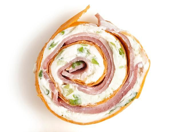 Ham Pinwheel  Spread scallion cream cheese on a sun-dried-tomato tortilla and top with thinly sliced ham. Roll up the tortilla and cut into 1/2-inch pieces.