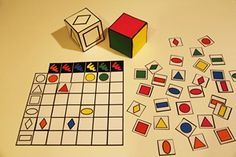 étiquettes pour le jeu du tableau - print off plain cubes and label with shape names and colour names (no pictures), students have to match up with the grid