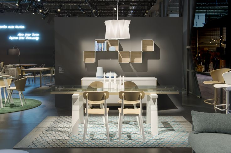 LEVANTE table / CREAM chairs /  BASIL chairs /  FRACTAL shelving unit /  ANDROMEDA suspension light /  BAHIA gas assist and swivel stools /  FACTORY side board