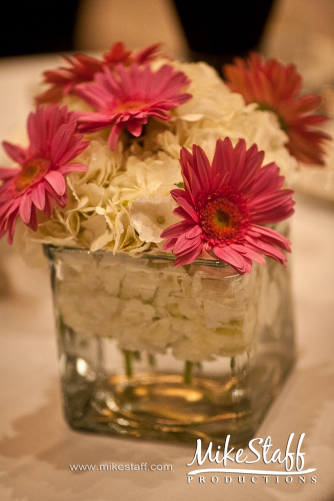 #wedding reception decorations #centerpieces #tablescapes #reception details #Michigan wedding #Mike Staff Productions #wedding details #wedding photography http://www.mikestaff.com/services/photography #short centerpieces #pink flowers #white flowers
