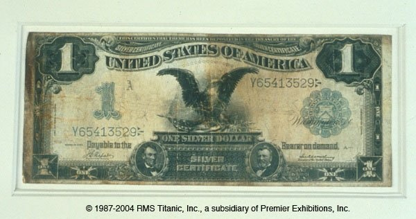 "Titanic Silver Certificate - This artifact, recovered from Titanic, is a form of currency known as a ""Silver Certificate"". Silver Certificates were common during the Victorian Era."