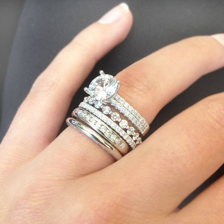 We all know diamonds are a girls best friend... so why not stack them up!? #Ritani engagement ring, #Tacori 18k white gold wedding band, and three #Memoire diamond wedding bands.