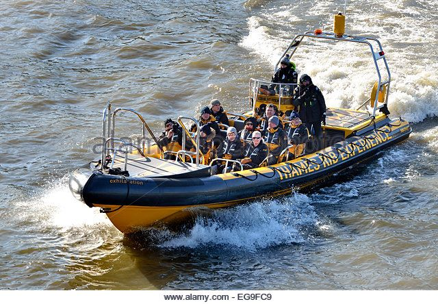 London, England, UK. Tourists on an inflatable boat of the Thames RIB Experience (Rigid Inflatable Boat) - Stock Image