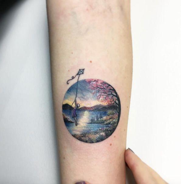 Detailed circular landscape tattoo by Eva Krbdk