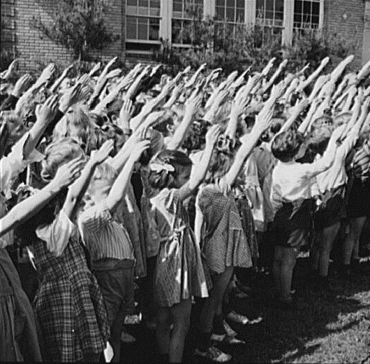 """The Bellamy salute, first demonstrated on October 12, 1892, was described by Francis Bellamy to accompany the American Pledge of Allegiance..."