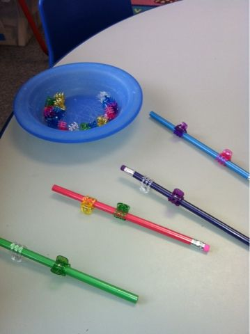 Pinning Clips on Colorful Dowel Rods or Pencils OR baby doll hair :)