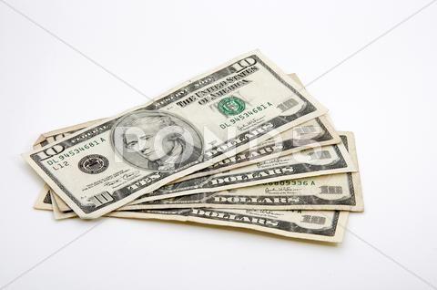 Ten-dollar bills spread out on white Stock Photos …
