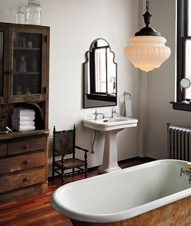 Classy vintage bathroom - The Schoolhouse light looks absolutely gorgeous!  Find more schoolhouse lights at www.FatShackVintage.com.au