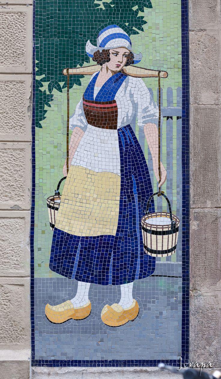 Catalan Mosaic Illustration, The Milk woman. La Lleteria, Poble Sec C/ Salvà 42 Barcelona Catalonia