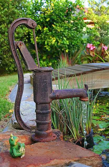 old pump, simple bridge and pond and resident frog ;-)