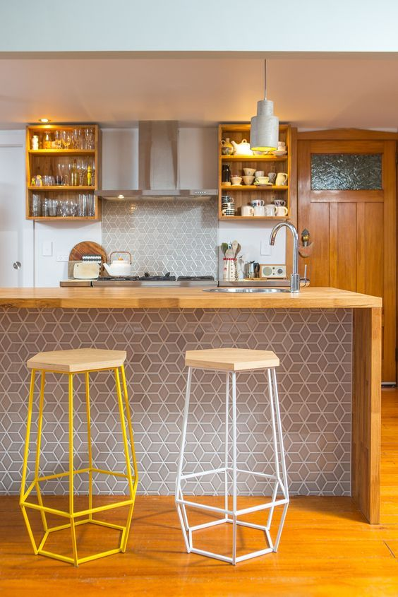 Warm tones. Kitchen 642. Sally Steer Design Ltd. Wellington, New Zealand. Fingerjointed American Oak benchtop with waterfall ends. Feature tile island back panel.: