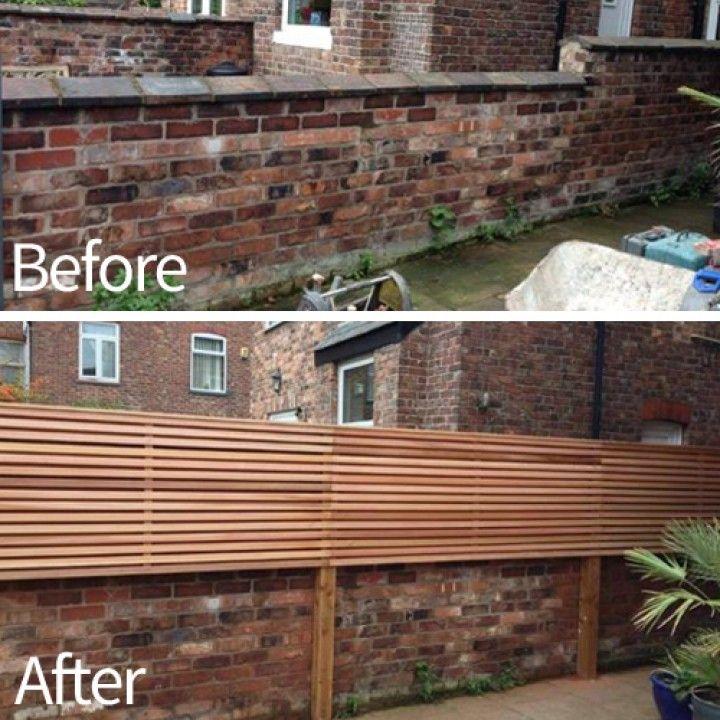 Brick wall and cedar fence