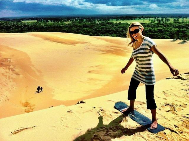 (that's me) ... sandboarding the massive Stockton Sand Dunes ... in Port Stephens, Australia