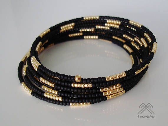 An elegant wrap bracelet made with 2mm Black frosted and Gold galvanized seed beads strung on a strong stainless steel memory wire. The ends have finished with gold plated bead end caps. Perfectly fits for a 6in to a 7in wrist. The bracelet will be sent in an organza gift bag within