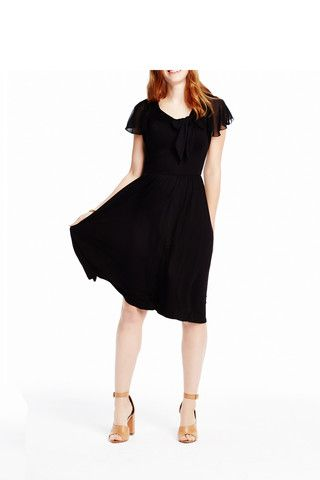 Easy breezy black jersey and chiffon dress. Available from Girls from Savoy.