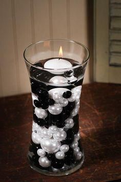 Black and White Faux pearls in the vases with floating candles
