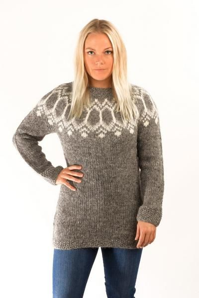 The Tight fit sweater is hand knitted from Icelandic unspun wool yarn. The  pattern is