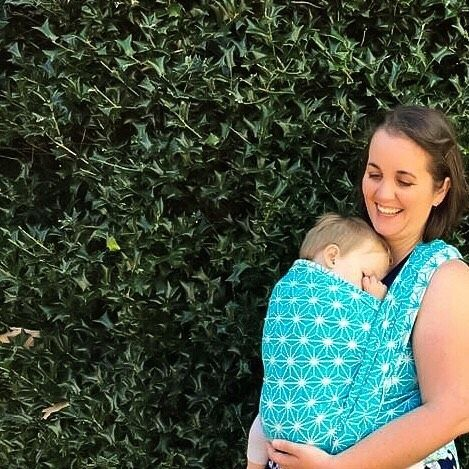 'Babywearing is helping them explore the world with you when they are not ready to without you' .  Close Enough to Kiss . And what better way to explore than guided by the stars in the stunning Australian made Celestial Sky by Chardan Slings  .  These soft and cushy 100% cotton beauties start at just $120 for a size 4 and $140 for a size 6 including Australia wide express shipping. .  @chardanslings . . . [close up image of a brown haired white woman carrying her sleeping blonde haired male…