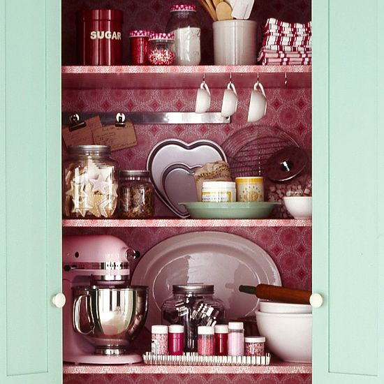 Baking Storage  With a fresh coat of turquoise paint, this repurposed armoire brightens the room as a pretty baking cabinet. Bifold doors conceal baking items and ensure accessibility. Shelves encourage tidiness within, making it easy to store mixing bowls, sprinkles, and ingredients.