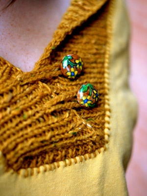 Repurposing an old hoodie sweatshirt with a blanket stitch and a knit or crochet collar.
