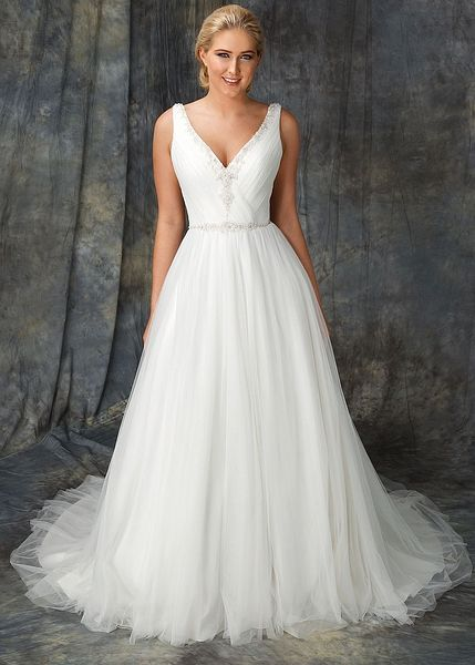 Sun is a beautiful A-Line gown designed with soft tulle for a delicate look. The Tulle is pleated over the bodice and features a V-neckline with beadwork which is carried up to the straps. The waistline is accentuated with an intricate hand-beaded belt detail and gathered tulle skirt for a gentle floaty look. - Wedding Dress by Berketex Bride