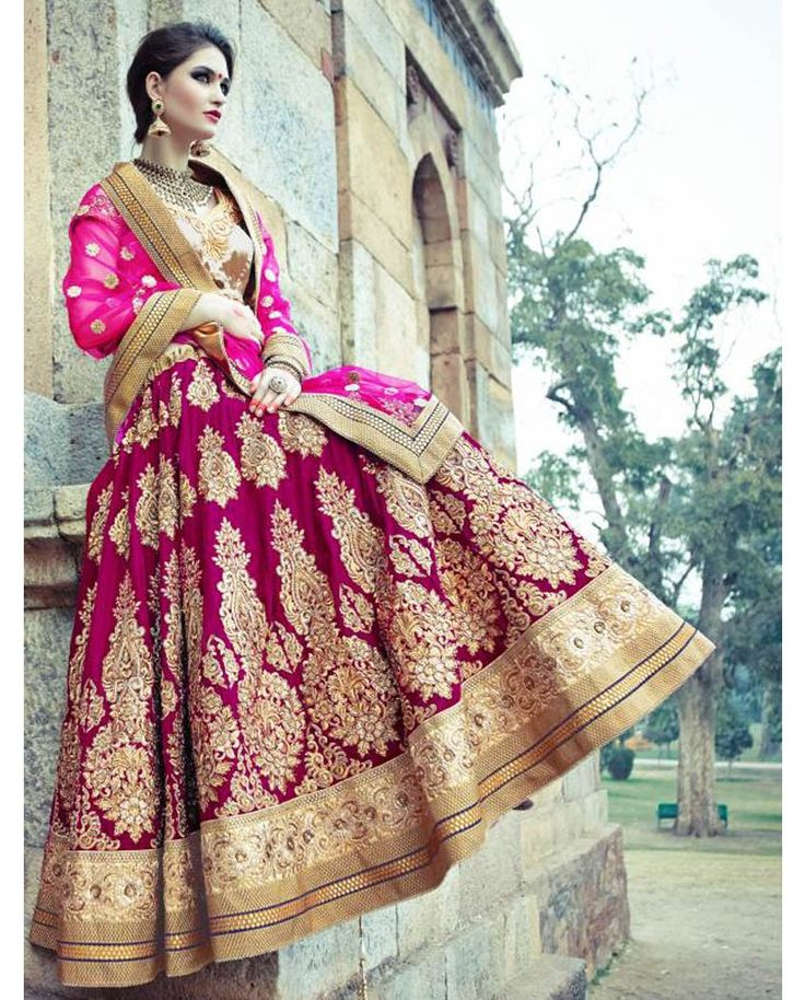 Magenta heavy embroidered lehenga with golden blouse   1. Magenta velvet embroidered lehenga2. Comes with unstitched blouse material and dupatta