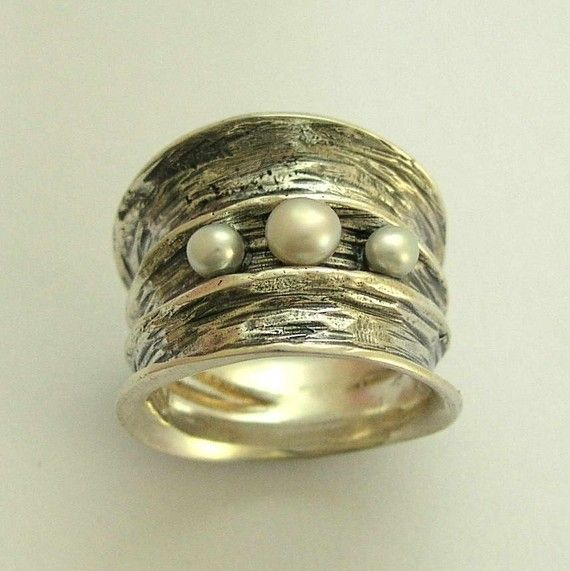 I found this on Etsy: Statement ring - Sterling silver ring inlaid 3 fresh water pearls - Bubbling emotions