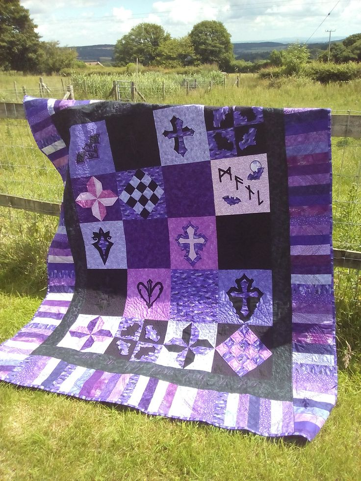 Black and purple Buffy the Vampire Slayer themed quilt. This one was a gift for a very close friend, and is mostly free motion quilted with snippets from our shared memories.