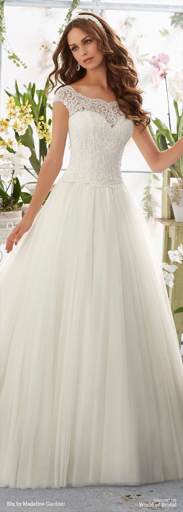 Embroidered Lace Overlays the Bateau Bodice on the Soft Net Ball Gown