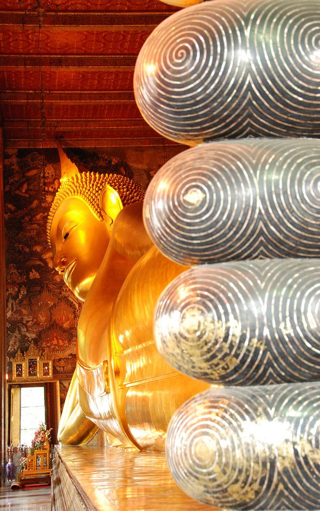 Reclining Buddha . Bangkok (Been here...just make sure you wear the right clothes or be punished by wearing a neon green robe.