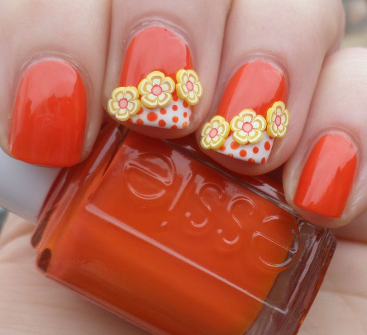 Summer nail art with fimo flowers and polka dots. I love the 70s vibe.